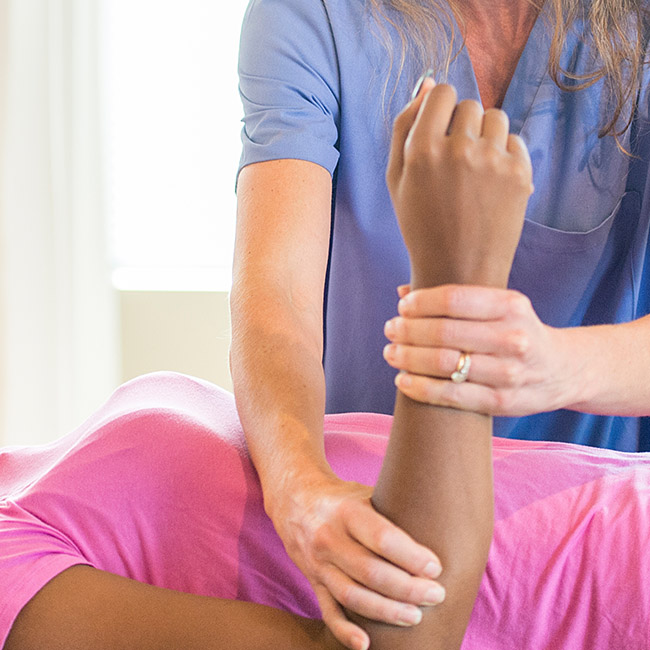 Patient receiving physiotherapy on arm