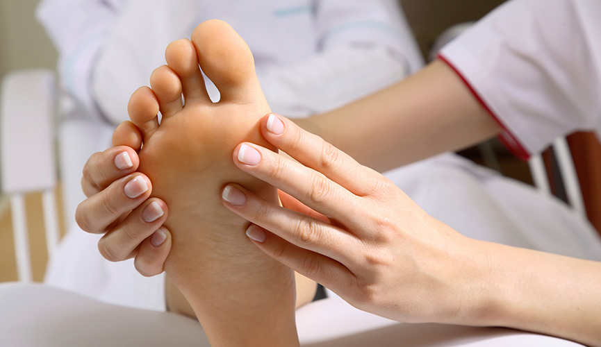 Patient's foot being evaulated