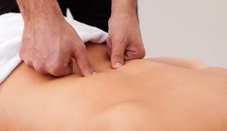 Patient receiving massage therapy on their lower back