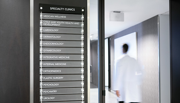 The front of a doctor's office showing a list of the different departments.