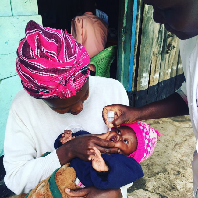 Local physician administers oral vaccine to child as part of Medcan Naweza program