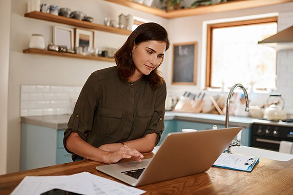 Woman researches healthcare options on her laptop.