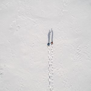 Couple walking together in the snow