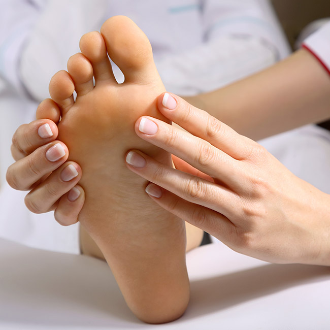 Patient receiving evaluation of their foot