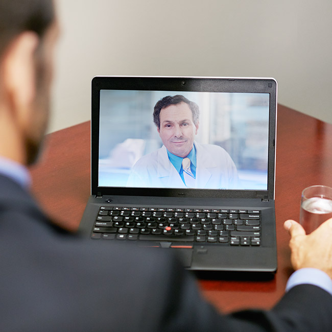Person speaking to a physician via video chat