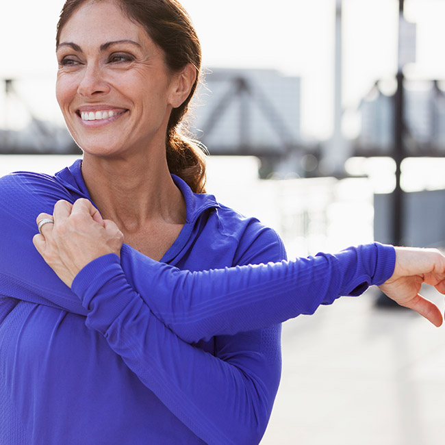 A woman stretches before exercising