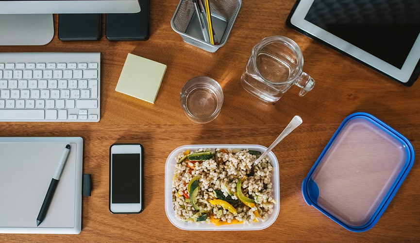 Desk with employee's packed lunch on it