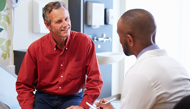 Physician consults with patient on program progress