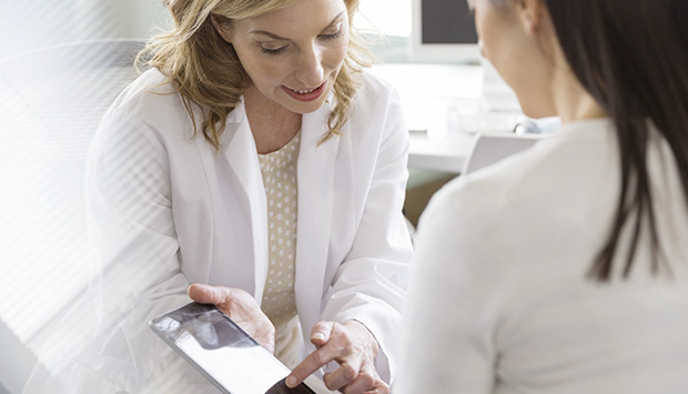 A physician reviews same-day results with a patient.