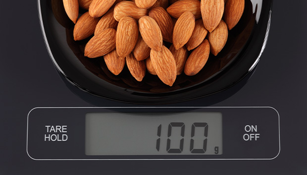 Almonds on a kitchen weigh scale