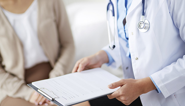 A physician holds their patient's documentation