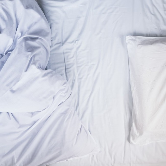 Empty unmade bed