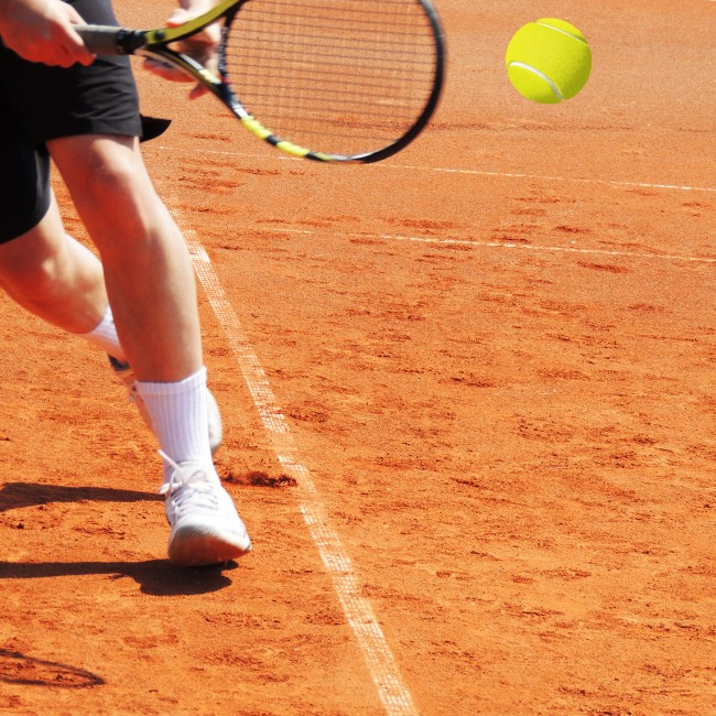 tennis player mid swing