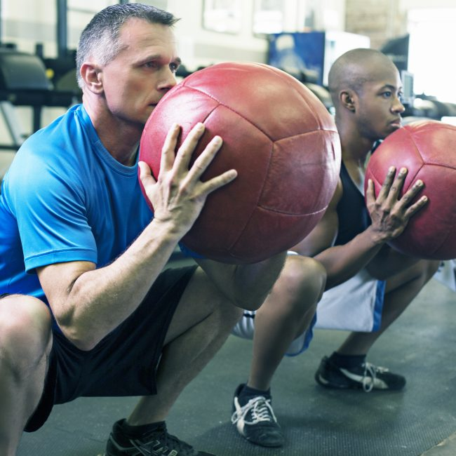 Two people with exercise balls