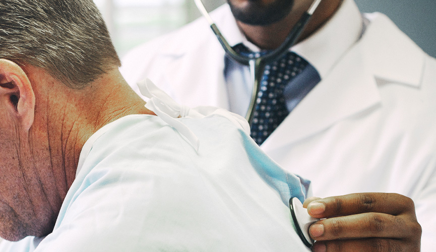 Physician assesses patient using stethoscope