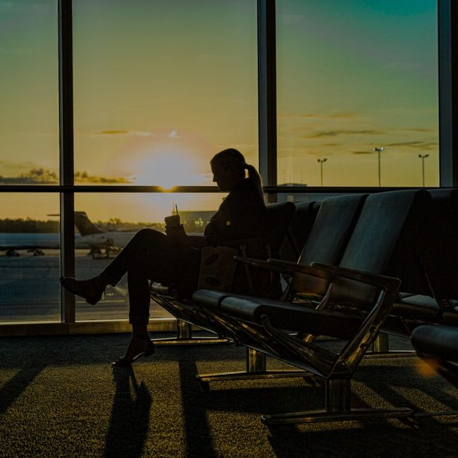 Person waiting at an airport terminal