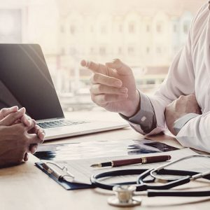 Physician meeting with patient