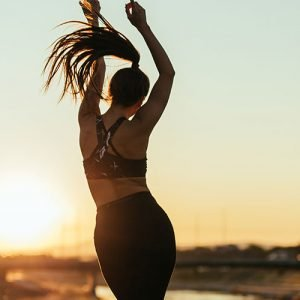 Woman dancing outside after work out