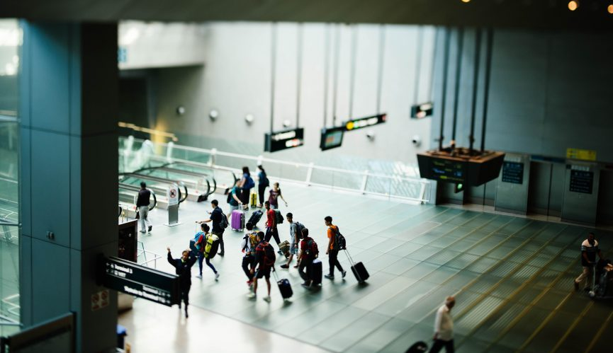 People traveling through an airport