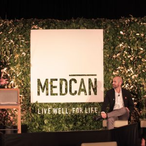 Medcan speakers at an event