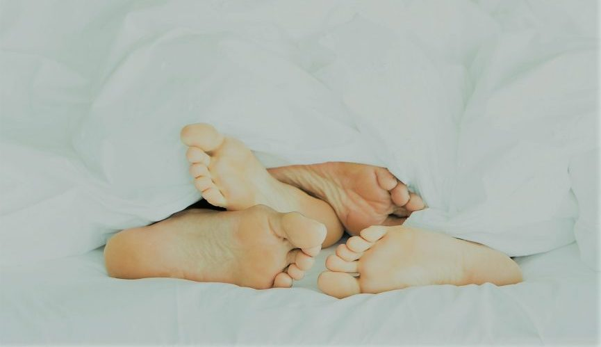 Two people in lying in bed together