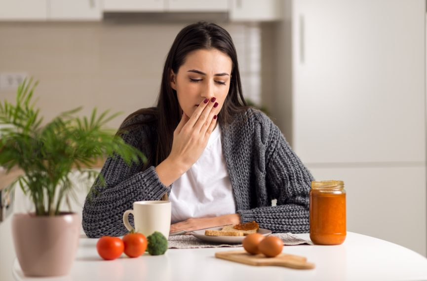 Woman experiencing digestive difficulty