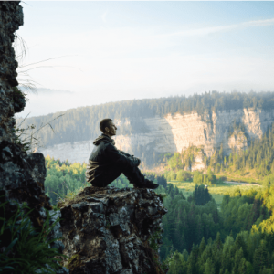 Person on a cliff relaxing
