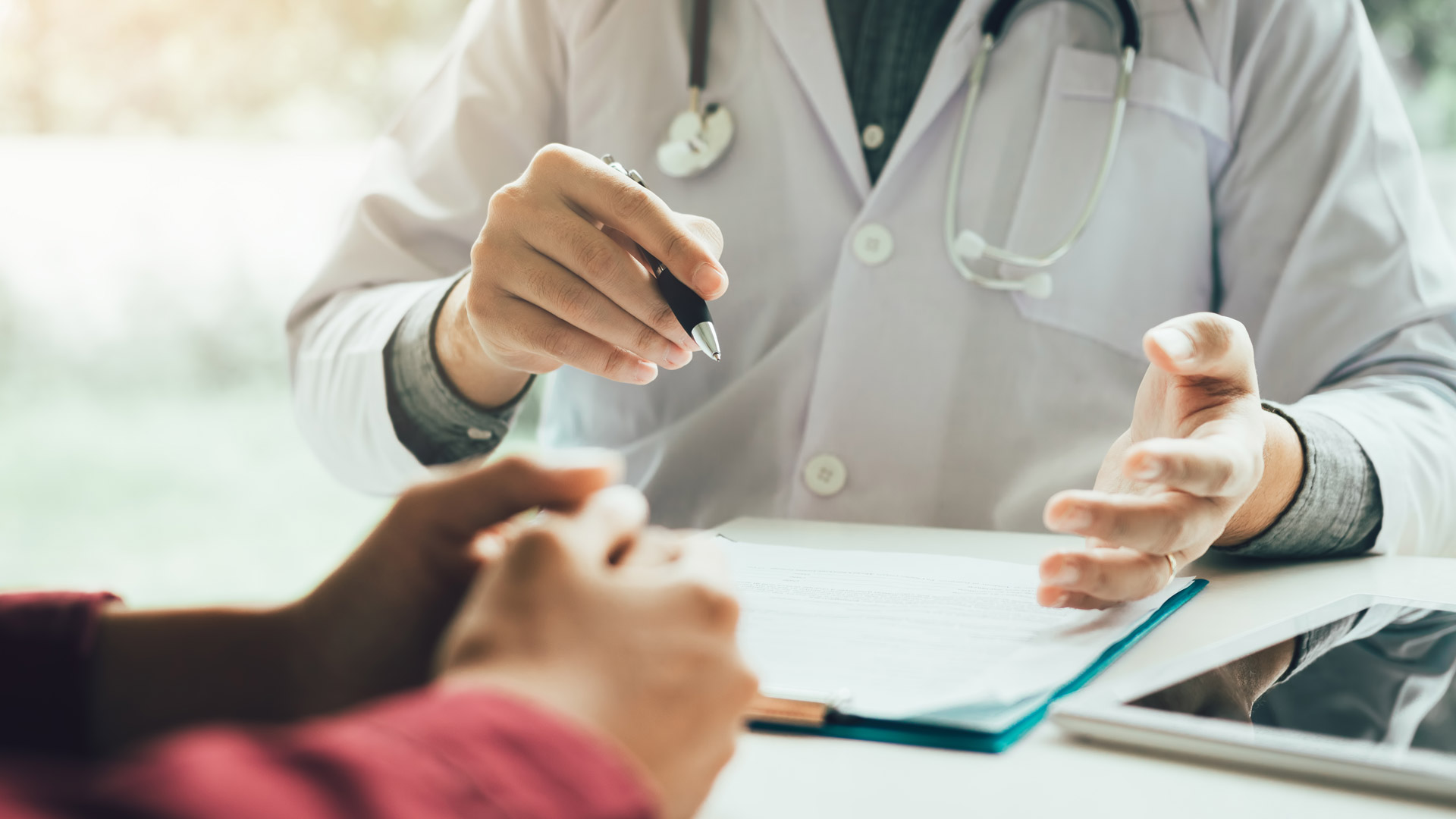 Physician reviews patient intake form