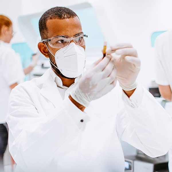 person in lab examining sample